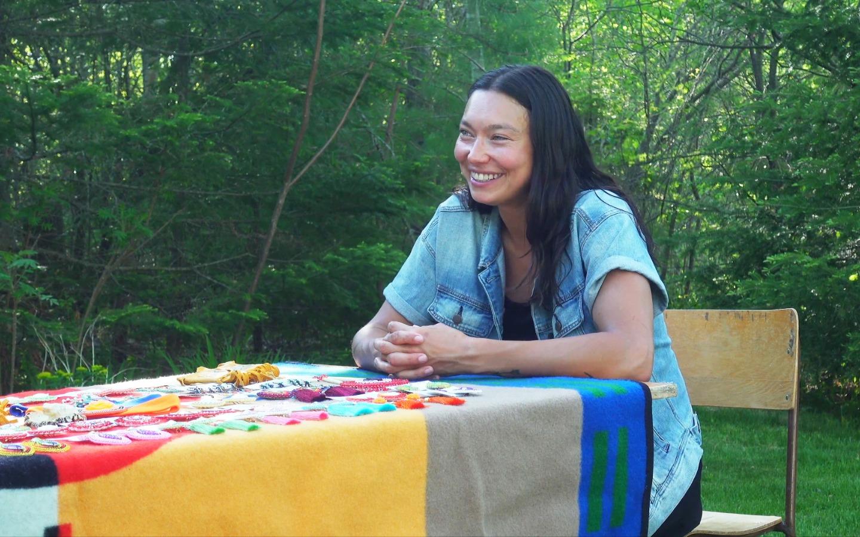 Sarain Fox sitting at a table
